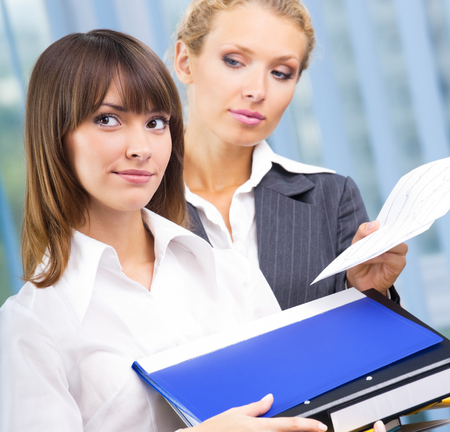 Businesswomen with documents at office Stock Photo