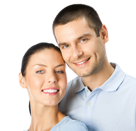 Portrait of young happy smiling attractive couple, isolated over white background