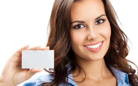 Happy smiling business woman showing blank business card, isolated over white backround Banque d'images