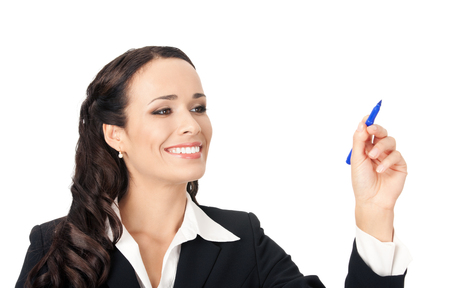 Happy smiling cheerful beautiful young business woman writing or drawing something on screen or transparent glass, by blue marker, isolated over white background Banque d'images
