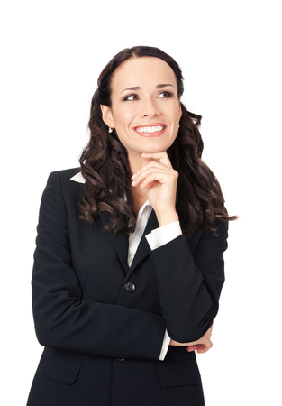 Happy smiling thinking or planning young business woman, isolated over white background