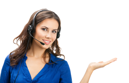 Portrait of happy smiling cheerful beautiful young support phone operator showing; isolated over white background Banque d'images