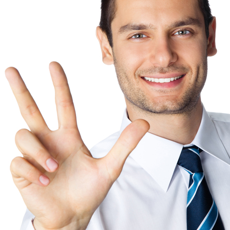 Portrait of happy smiling businessman showing three fingers, isolated over white background