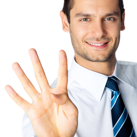 Portrait of happy smiling businessman showing four fingers, isolated over white background Stock Photo