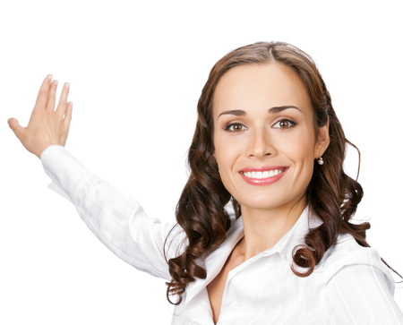 Happy smiling young business woman showing blank area for sign or copyspase, isolated over white background Archivio Fotografico