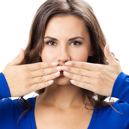 Young woman covering with hands her mouth, isolated over white background Stock Photo