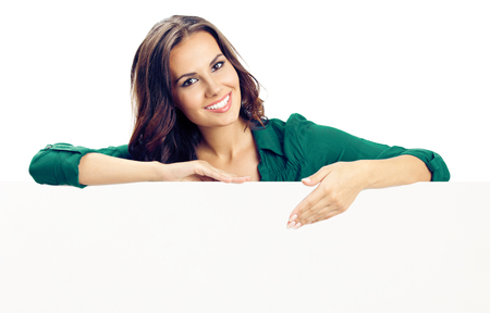 Happy smiling young woman showing blank signboard or copyspace for advertise, slogan or text, isolated against white background Reklamní fotografie - 95904740