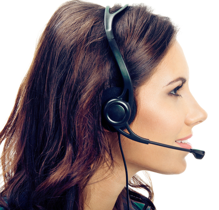 Profile portrait of happy smiling young support phone operator in headset, isolated against white background Stockfoto
