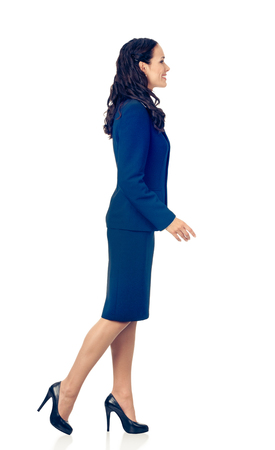 Full body portrait of going young happy smiling business woman in blue confident suit, isolated over white background