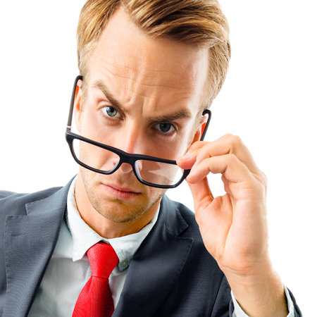 Are you seriously?! Full body portrait of funny skeptic young businessman in black confident suit and red tie, looking through glasses, top angle view shot, isolated against white background. Business concept. Banque d'images