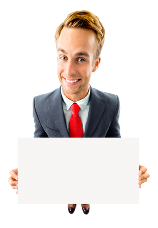 Full body portrait of funny young businessman in black confident suit and red tie, showing blank signboard with copyspace area for advertising text or slogan, top angle view shot, isolated against white background. Business concept. Banque d'images