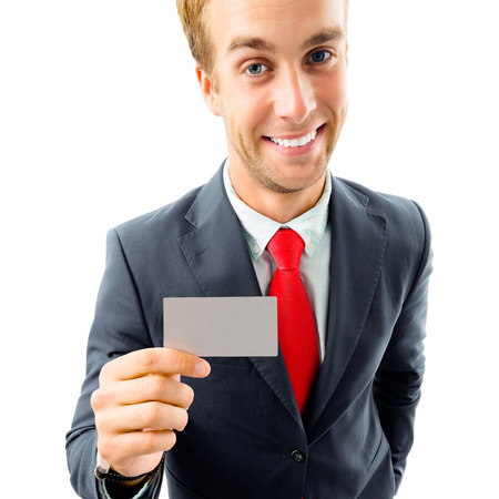 Full body portrait of funny businessman in black confident suit and red tie, showing blank business or plastic credit card, with copyspace area for text or slogan, top angle view shot isolated on white