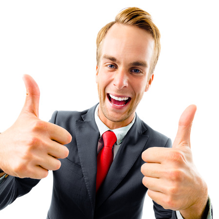 Full body portrait of funny businessman in black confident suit and red tie, showing thumbs up gesture, top angle view shot, isolated against white background. Business concept.
