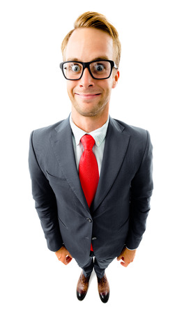 Full body portrait of funny young businessman in glasses, black confident suit and red tie, top angle view shot, isolated against white background. Business concept.
