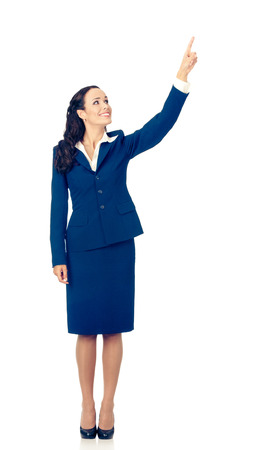 Full body of happy smiling young beautiful business woman in blue confident suit, showing up on something or copyspace area for product or sign text, isolated over white background 写真素材