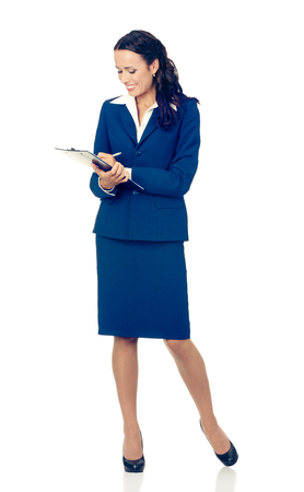 Full body of writing young happy smiling business woman in blue confident suit, with clipboard, isolated over white background