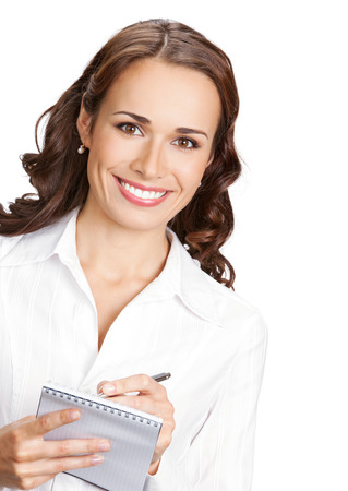 Happy smiling cheerful young business woman with notepad writing, isolated on white background