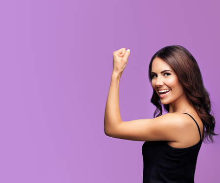 Portrait of cheerful smiling young woman happy gesturing, over violet background, with blank copyspace area for slogan or text