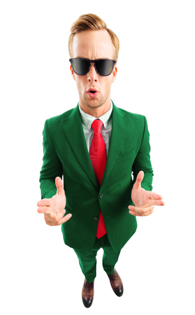 I am cool! Full body portrait of funny young businessman in sunglasses, green confident suit and red tie, top angle view shot, isolated over white background. Business concept.