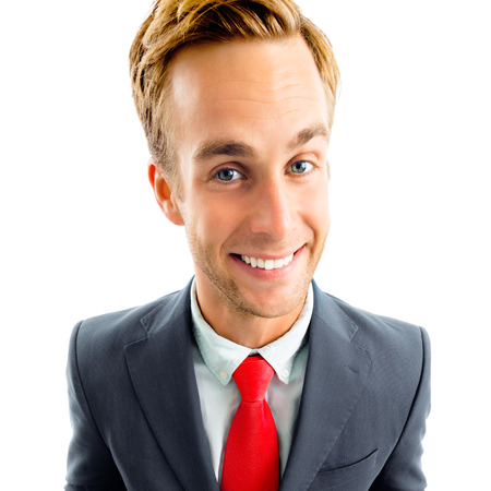 Portrait of funny young businessman in black confident suit and red tie, isolated against white background. Business concept.