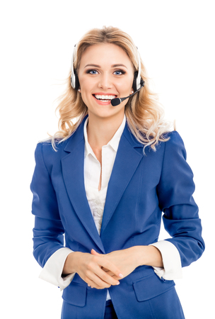 Call center. Smiling female support phone operator in blue confident suit and headset, isolated over white background. Caucasian blond model in customer service help consulting concept. Imagens