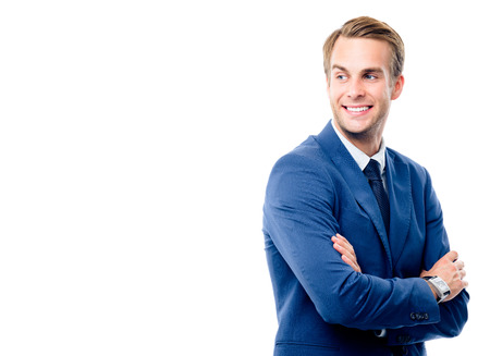 Portrait of happy smiling young businessman in blue confident suit, standing in crossed arms pose, looking back, isolated over white background. Success in business concept studio shot. 版權商用圖片