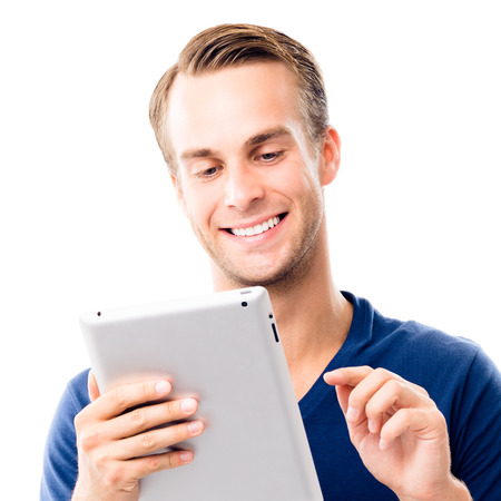 Portrait of happy smiling young man in blue smart casual clothing, using no-name tablet pc, isolated over white background