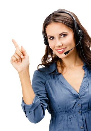 Portrait of happy smiling cheerful beautiful young support phone operator showing; isolated over white background Banque d'images - 115400623
