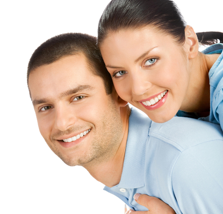 Portrait of young happy smiling attractive couple, isolated over white background Banque d'images - 115400690