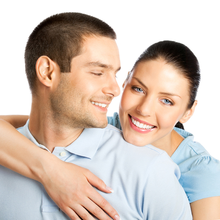 Portrait of young happy smiling attractive couple, isolated over white background Banque d'images - 115400692