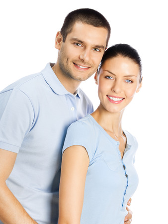 Portrait of young happy smiling attractive couple, isolated over white background Banque d'images - 115400694