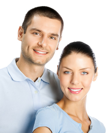Portrait of young happy smiling attractive couple, isolated over white background Banque d'images - 115400695