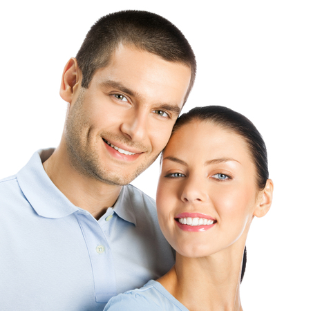 Portrait of young happy smiling attractive couple, isolated over white background Banque d'images - 115400696