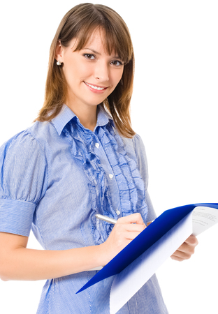 Happy smiling cheerful young business woman writing on documents, isolated on white background Banque d'images - 115400876