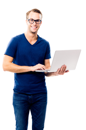 Can I help You? Portrait of happy smiling young man in glasses and blue smart casual wear, working with laptop, isolated over white background. Stok Fotoğraf