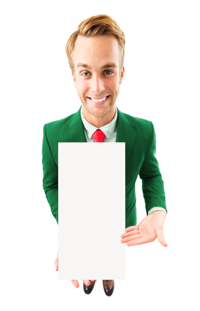 Full body portrait of funny young businessman in green confident suit and red tie, showing blank signboard with copyspace area for advertising text or slogan, top angle view shot, isolated over white background. Business concept.
