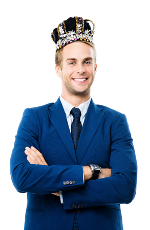 I am business king! Portrait of happy smiling young businessman in crown, isolated on white background. Leadership and business success concept.
