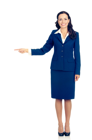 Full body of happy smiling young beautiful business woman in blue confident suit, showing on something or copyspace area for product or sign text, isolated over white background