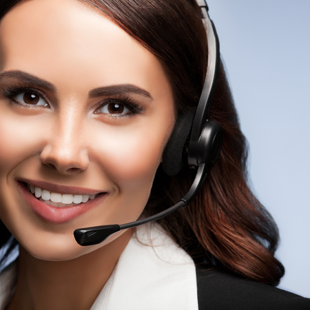 Call center. Customer support service phone operator in headset. Brunette model in business success concept shot.