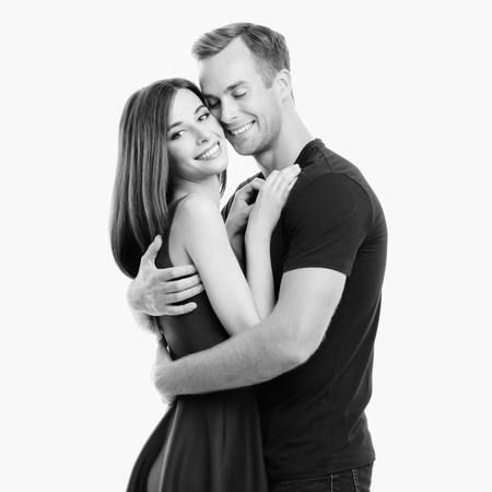 Portrait of young happy hugging couple, looking at camera with smile. Caucasian models in love, relationship, dating, flirting, lovers, concept. Black and white.