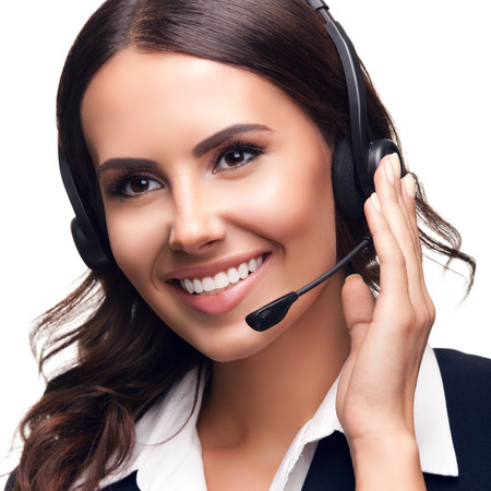 Portrait photo of smiling customer support phone operator, isolated against white background