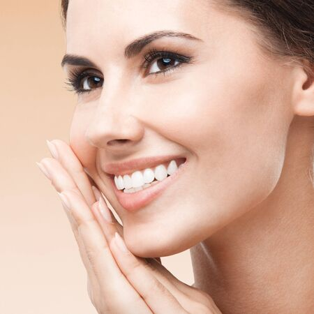 Young happy smiling woman, on color background. Caucasian female model in beauty, healthcare, skincare, face, dental health concept picture. Square composition.