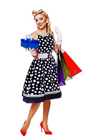 Full body of girl in pinup style dress, holding gift box and shopping bags, isolated over white background. Caucasian blond woman - sales, consumer and retro fashion. Raster vintage illustration. Stock Photo