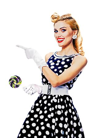 Happy excited woman in pin up style dress, showing something or copy space for some text, slogan or message, isolated over white background. Retro fashion advertising concept. Raster vintage illustration concept.