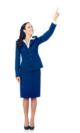 Full body of happy smiling business woman in blue confident suit, showing up on something or copy space for some slogan, sign or text, isolated over white background
