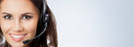 Portrait of happy smiling support phone operator, businesswomen in headset, or sales agent, with blank copy space area for slogan or text Stock Photo