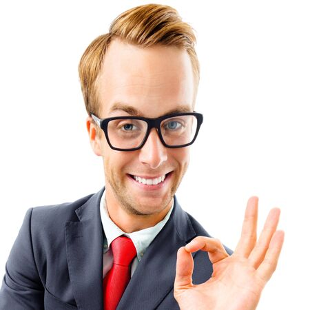 OK! Funny happy excited businessman in glasses showing ok gesture or zero, confident suit and red tie, isolated over white background. Business concept square composition picture.