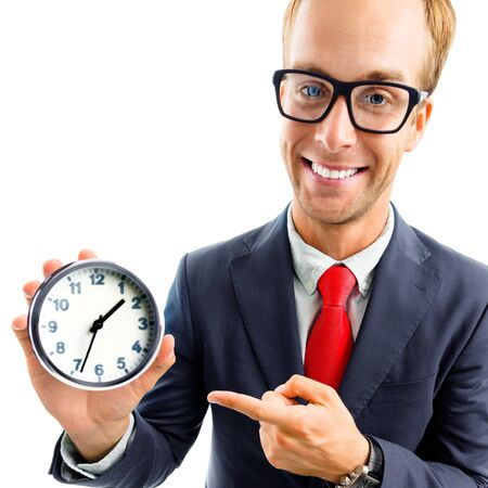 Full body portrait of funny happy businessman in glasses showing clock, confident suit and red tie, top angle view shot, isolated over white background. Business and time concept.