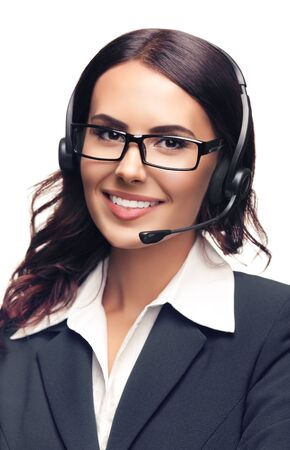 Portrait of smiling customer support phone operator in glasses and grey confident suit, isolated against white background