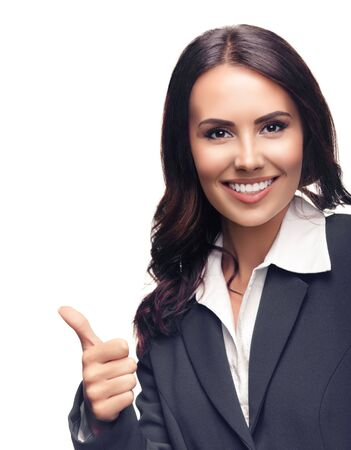 Happy smiling beautiful young businesswoman showing thumbs up gesture, in grey confident suit, isolated against white background 스톡 콘텐츠